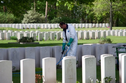 Commonwealth War Graves Commission gardeners tend to the cemetery.
