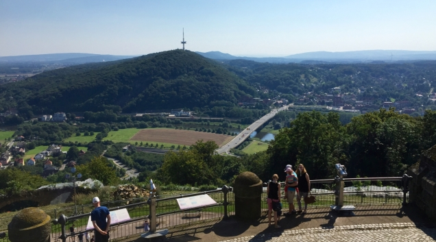 The Kaiser memorial at Porta Westfalica gives a great view of the surrounding hills and forests. At the bank of the river Weser, bottom, you can see the railway station built for the monument.
